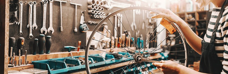 Illuminated bycicle wheel in workshop